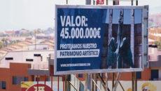 Eine Werbetafel an der Nordautobahn ruft dazu auf, das Franco-Denkmal zu schützen. Foto: EFE
